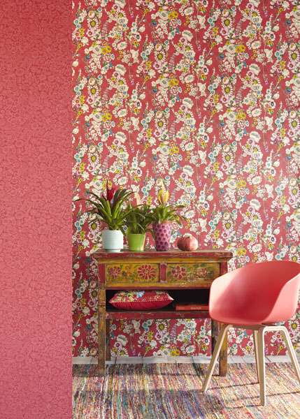 Exotic plants decor idea with vintage inspired red floral wallpaper