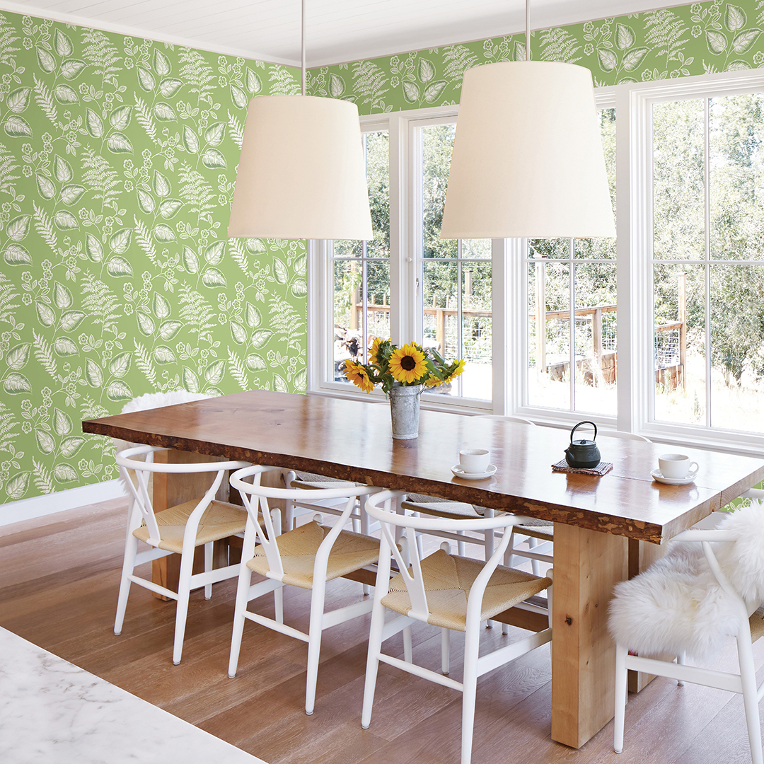 Modern dining area with green botanical wallpaper