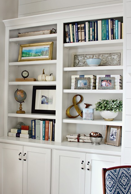 Styling A Bookshelf Mix Family Photos In With Art