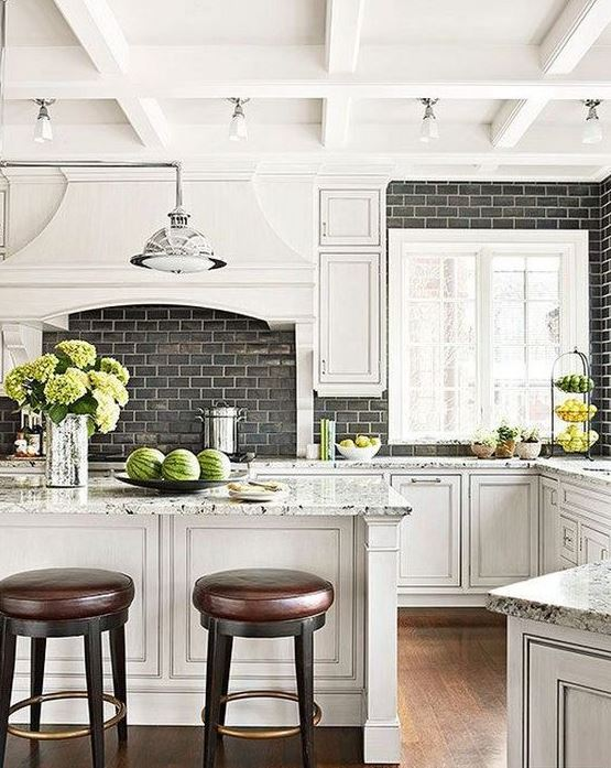 Black subway tile in traditional kitchen