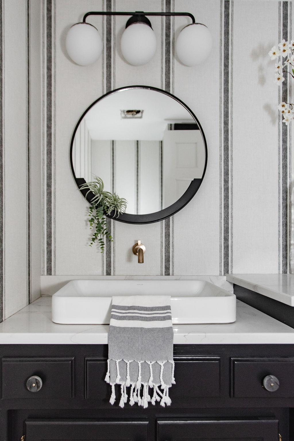 A bathroom renovation's modern take on classic black & white design