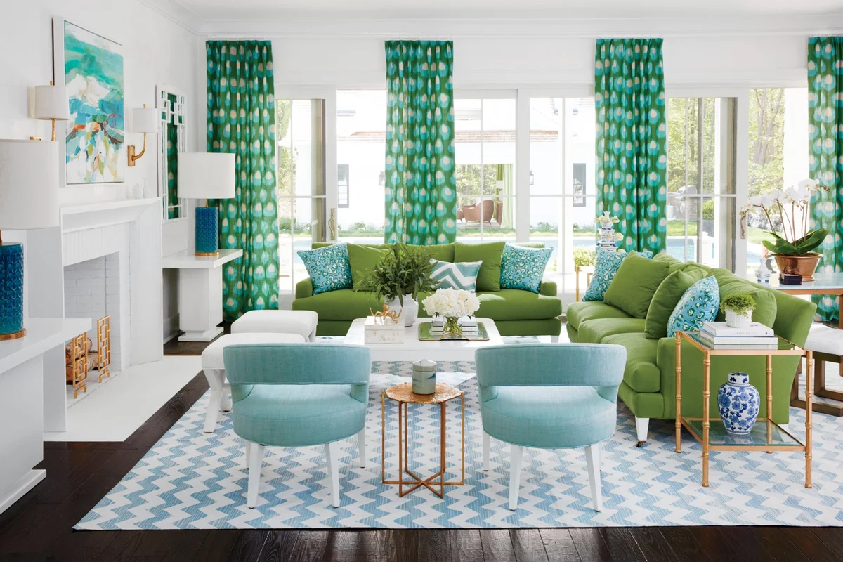 Beautiful coastal living room featuring two-tone blue and green decor