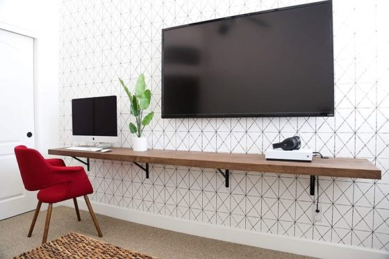 This work from home office is simple and sleek with a black and white intersection wallpaper.